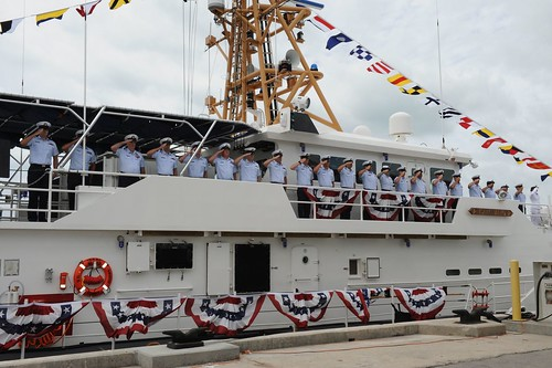 Crewmembers man the U.S. Coast Guard Cutter Isaac Mayo for the first time after its commissioning and salute symbolizing they have officially manned their stations, March 28,2015. The Coast Guard 7th District welcomed their 12th fast response cutter to the fleet in Key West, Fla. U.S. Coast Guard photo by Lt. j.g. Pete Bermont.