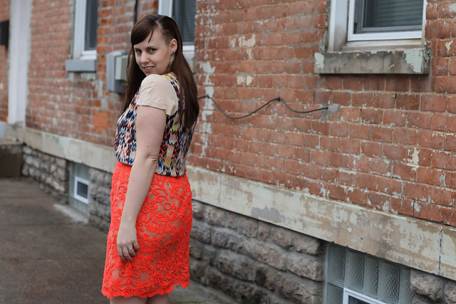 Orange outfit: Anthropologie coral embroidered pencil skirt, silk chevron blouse, suede ankle boot, shaved side undercut hairstyle
