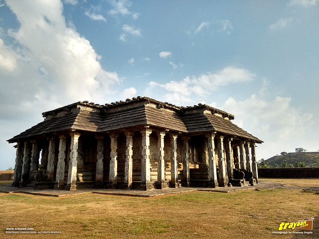 Tribhuvana Tilaka Jina Chaityalaya or Ratnatraya dhama, the Chaturmukha Basadi of Karkala with the Bahubali Gommateshwara monolith on the hill in the background, Udupi district, Karnataka, India