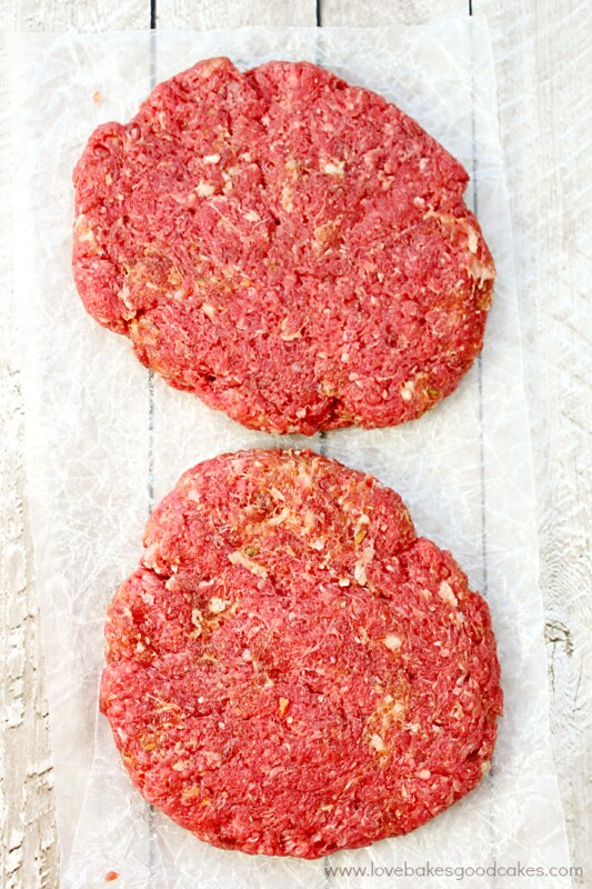 Raw hamburger patties being made into an Italian pepperoni burger.