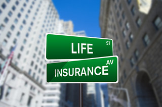 Life Insurance Street Sign On Wall Street | by investmentzen