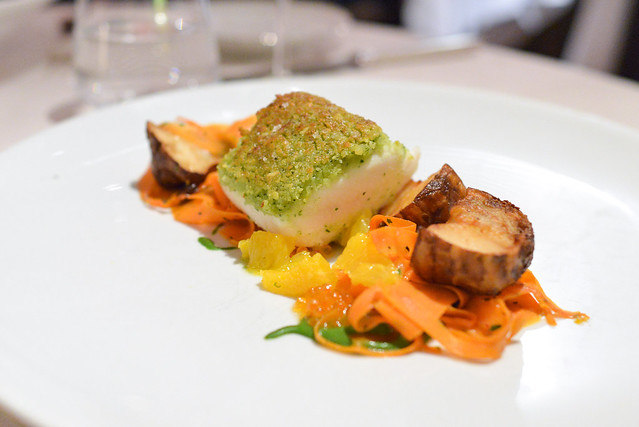 IPPOGLOSSO crusted canadian halibut, carrots, sunchokes, almonds, blood orange
