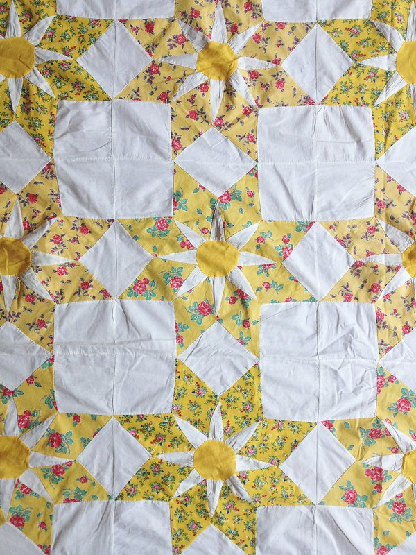 Yellow star patchwork quilt