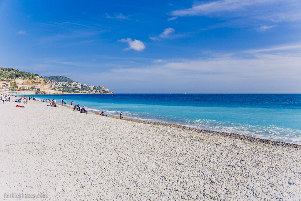 White pebble beach and teal water in Nice