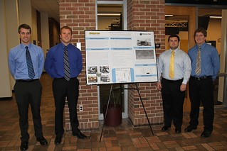 MacLean-Fogg Component Solutions—Mine Bit Manufacturing Process Team posing with poster