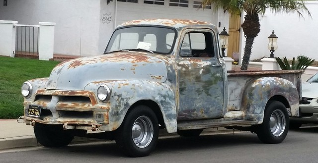 Beat up Chevy truck.