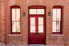Bricks and red door and windows. by dclatfel