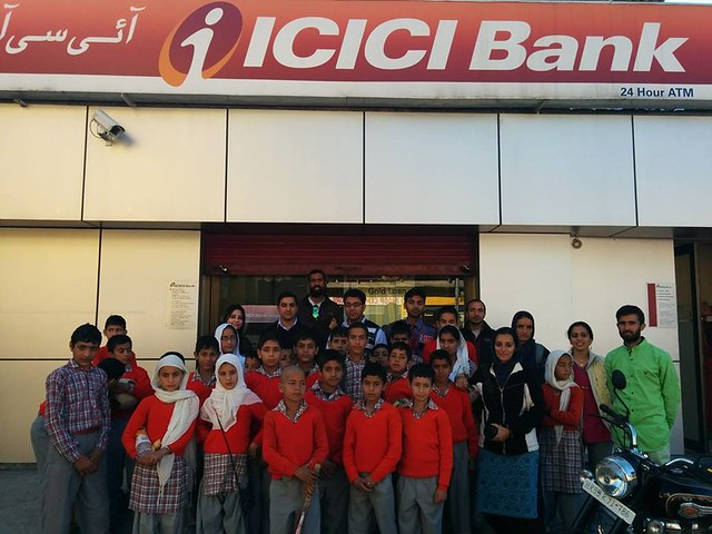 Students of Haji Public school on an educational trip to ICICI bank in Baderwah town to know about working of an ATM machine