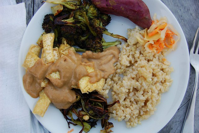 Tofu with peanut sauce, roasted broccoli & spring onions, brown rice & pickled daikon by Eve Fox, The Garden of Eating, copyright 2015