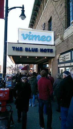 white Vimeo sign