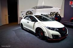 family car(0.0), automobile(1.0), automotive exterior(1.0), exhibition(1.0), wheel(1.0), vehicle(1.0), automotive design(1.0), auto show(1.0), honda(1.0), honda civic type r(1.0), sedan(1.0), land vehicle(1.0), hatchback(1.0), sports car(1.0),