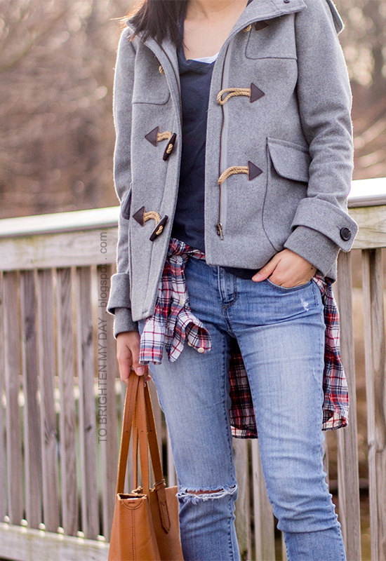 gray toggled coat, navy tee, plaid shirt, cognac brown tote