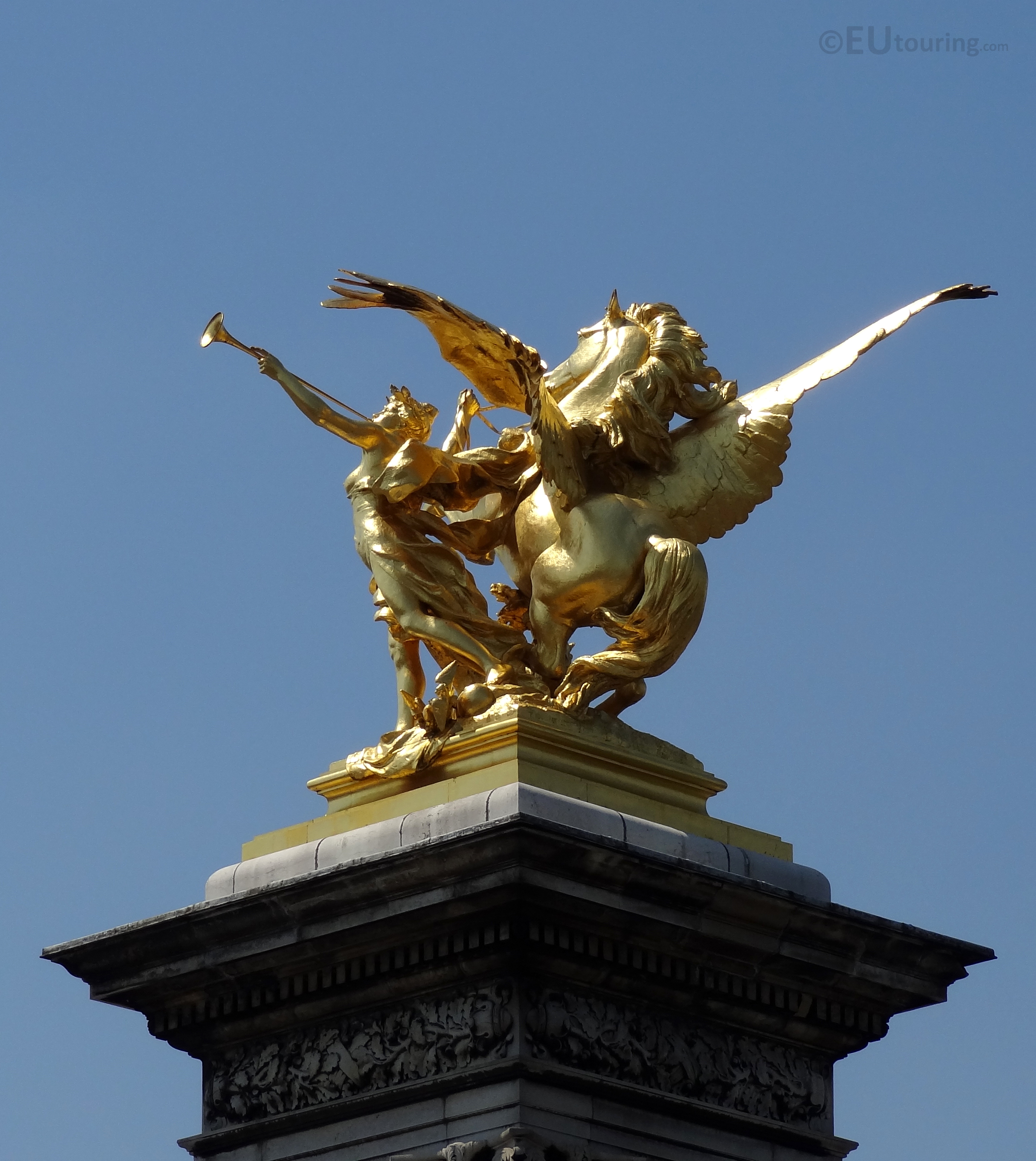 Golden statue of Fame and Pegasus