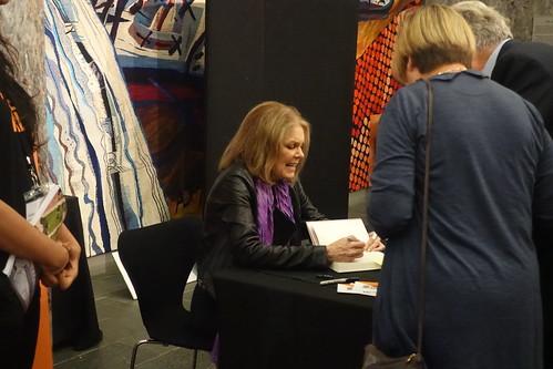 Gloria Steinem at the signing desk