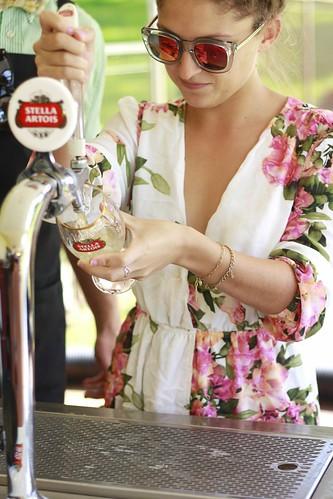 Little Miss Mon Bon pouring a drink