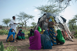 Health Extension worker, Abdulallh Abiib, 22, discuss hygine prctices with a women's group in Koro kebele.