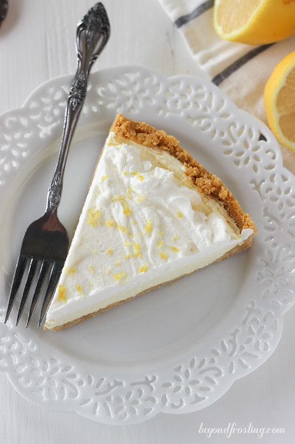 This Lemon Ice Cream Pie is the perfect dessert for summer time. Lemon Oreo crust, with a lemon cheesecake mousse filling and topped with whipped cream.