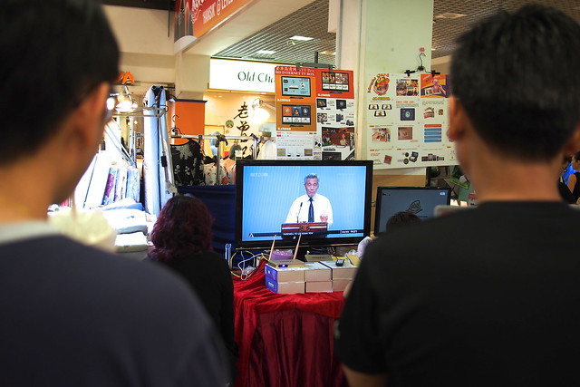 watching Lee Kuan Yew's state funeral at Heartland Mall