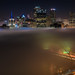Pittsburgh is engulfed in fog as the Ft. Pitt Bridge glows in the early morning by Dave DiCello
