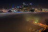 Pittsburgh is engulfed in fog as the Ft. Pitt Bridge glows in the early morning