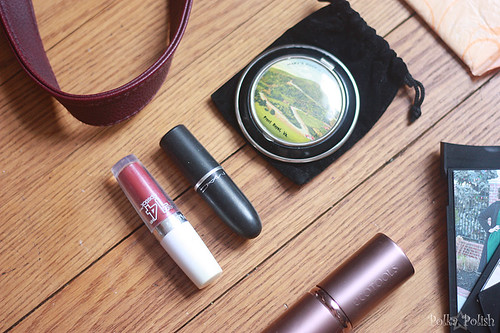 The makeup that lives in my purse: MAC & Maybelline lipstick, a vintage tourist compact, and a powder brush