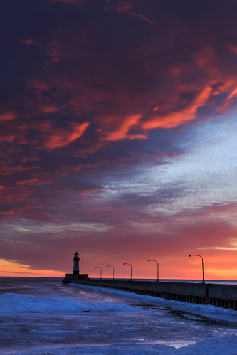 winter lighthouse reflection minnesota clouds sunrise duluth