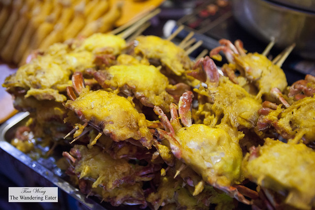 Fried skewers of small crabs