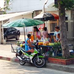 Street vendor selling fruit.
