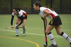 tackle(0.0), stick and ball games(1.0), sports(1.0), team sport(1.0), hockey(1.0), field hockey(1.0), player(1.0), ball game(1.0),