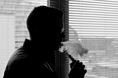 Vaping Man With Electronic Cigarette / E Cig / Vapouriser