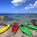 beach at Costa del sol with kayaks by tmikuls
