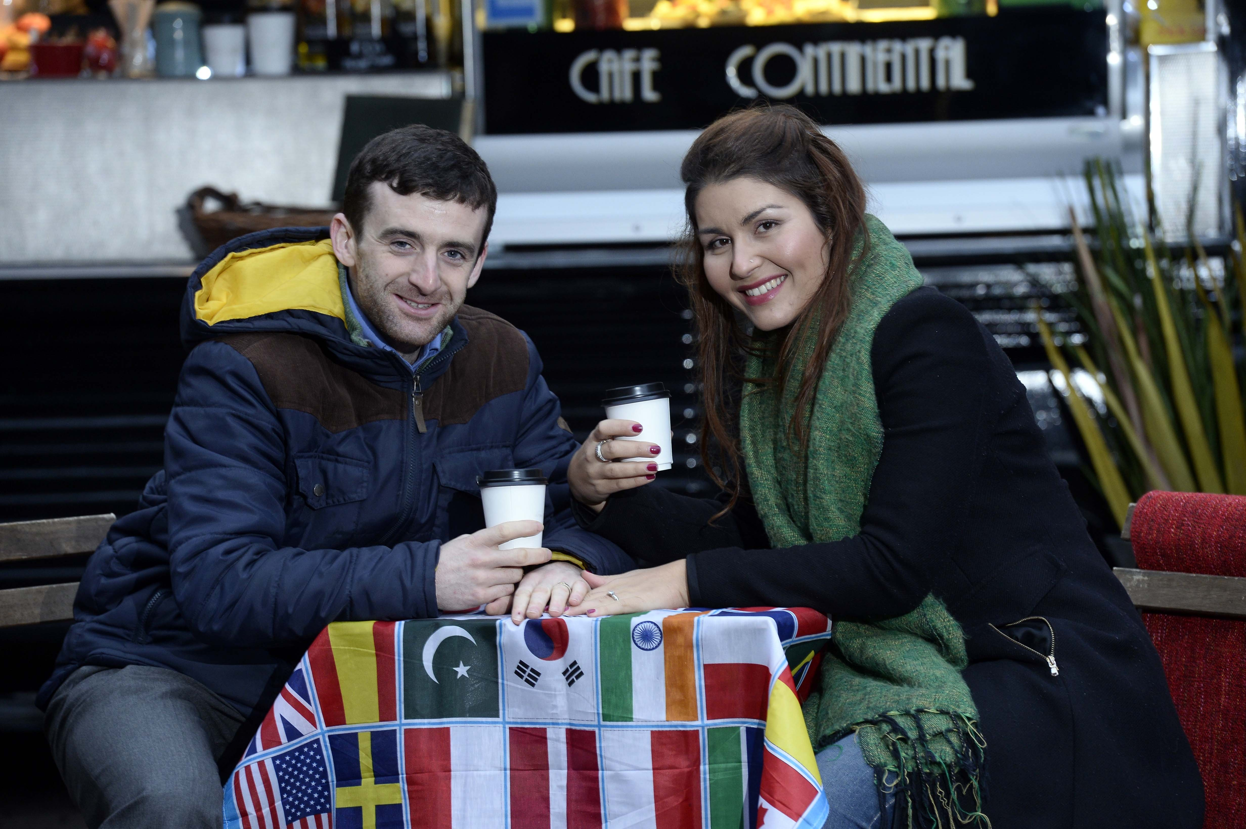 Raquel Rodrigues Keenan and her husband Conor, sharing a coffee together abroad