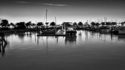 sky blackandwhite bw usa lake reflection water monochrome sign sailboat marina sunrise landscape dawn lights harbor boat dock lowlight florida clear sanford centralflorida edrosack em5markiihighres