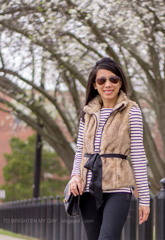 faux fur vest, striped tee, black pants