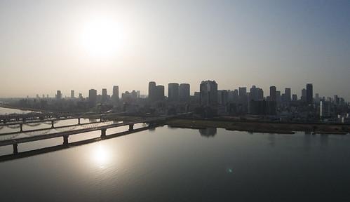 city bridge sky sun japan skyscraper sunrise river cityscape calm osaka phantom umeda cityskyline airphotography