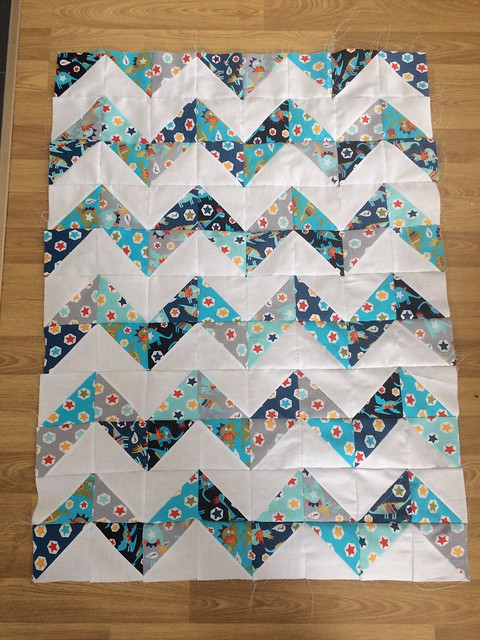 All sewn together. I wish I had enough to do one more line across the top to finish the chevron :( but nope, this'll have to do. I'm thinking of constructing it like my last one, with a border and then without binding.