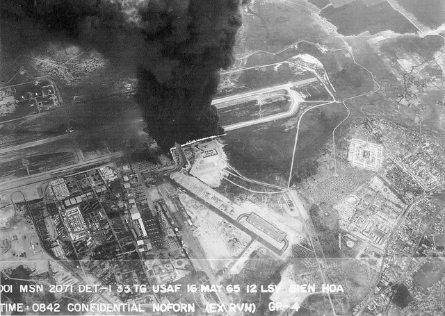 Bien Hoa Disaster (May 16, 1965) - Burning aircraft on ramp at Bien Hoa AB - Aerial view