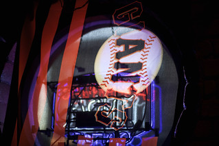 Giants Flag Behind the Neon