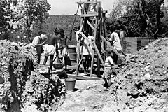Deepening water well, India, 1950