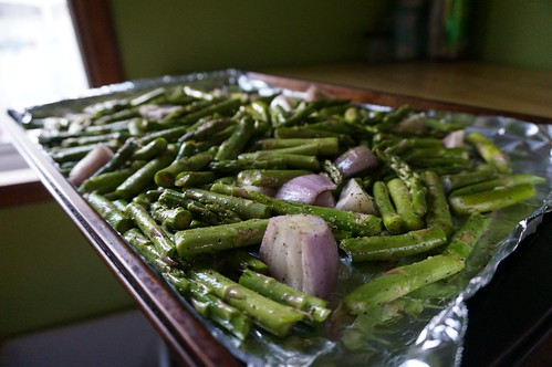 A tray of asparagus and shallot pieces, ready for roasting