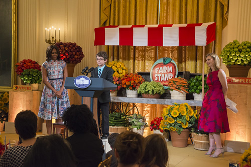 At the 2014 Kids' State dinner at the White House, Braeden Mannering, the 2013 Kid's State Dinner winner from Delaware, introduces First Lady Michelle Obama at last year's Kid's State Dinner in East Room of the White House.
