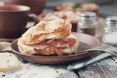 puff pastry with cheese and tomato . Toned photo