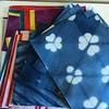 Today's challenge: to turn this pile of fabric into four more #leatherhandledlinentotes! #indigodyed #itajime #shibori #fbp