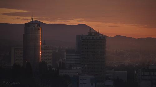 zagreb croatia sunrise dawn buildings architecture cityscape purple city urban outdoor morning reflection sun light