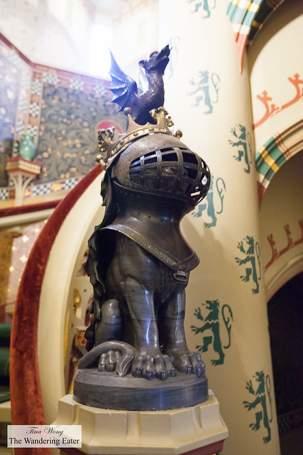 Sculpture of a lion in a knight's helmut with a dragon on top
