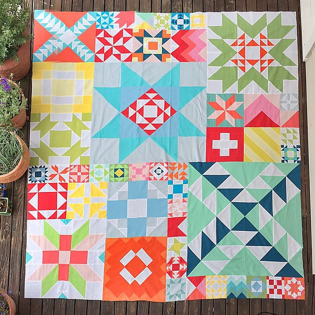 Finished! It's crazy big, I had to stand on a ladder and use panorama function on my phone to get it all in (hence the distortion). Still think it's super-busy. #modabuildingblocks #modernbuildingblocks #mondaymodern #quilt #patchwork