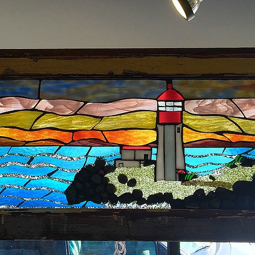 Yvonne Dywne glass artist... Beautiful glass work in a vintage window casing!