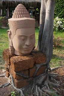 Carved head at Artisans d'Angkor