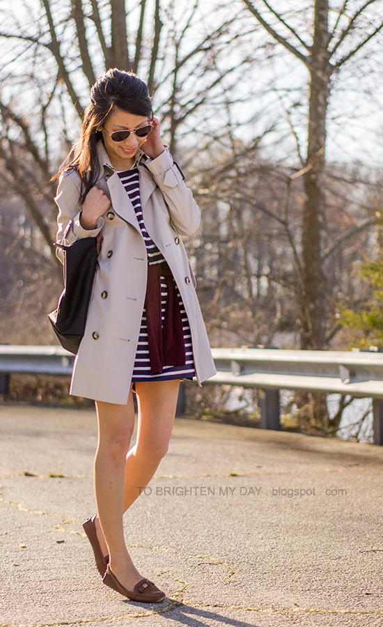 trench coat, striped dress, burgundy sweater, brown loafers