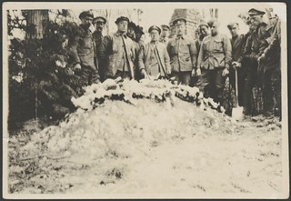 British Labour Corps workers, who conducted the burial, pose behind the grave of Manfred von Richthofen, Bertangles, France, 22 April 1918 / John Joshua